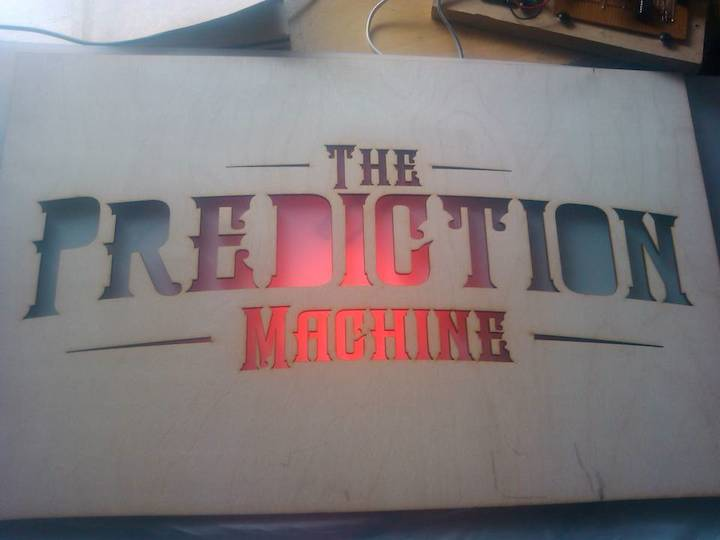 The Prediction Machine test sign with LED lights behind it