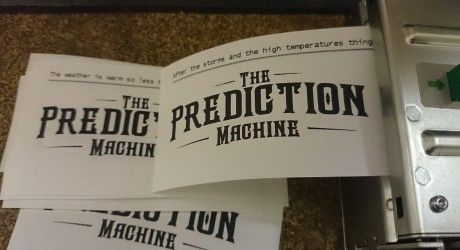 printer with test predictions printing and the The Prediction Machine logo