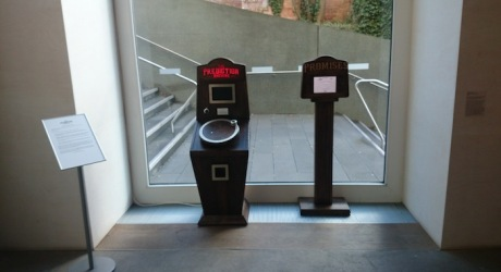 The Prediction Machine and the Promises and Wishes Machine installed in the window with a stand with instructions and