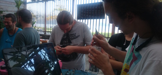 Participants building Arduino controllers for the music box and rain controlled shower